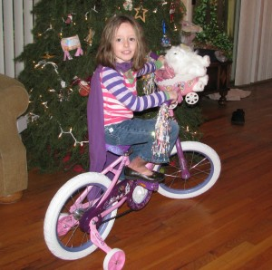 My grand daughter Alinea Rae, who as my father promised, brings a smile to my face just by entering a room. On her new bicycle, Christmas 2012.